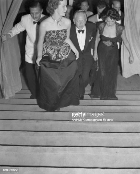 American actress Betsy Blair wearing an evening dress portrayed while getting up the stairs Lido Venice 1949