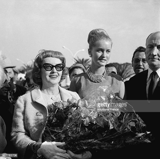 American actress Bette Davis arrives at the Carlton Hotel with daughter Barbara before the presentation of director Robert Aldrich's movie 'What Ever...