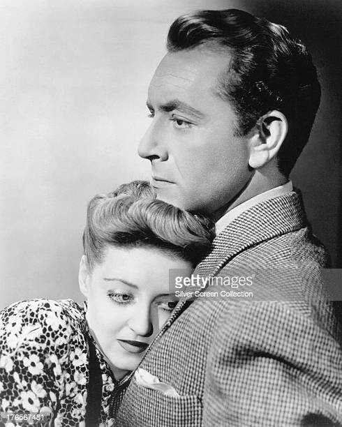 American actress Bette Davis as Charlotte Vale and Paul Henreid as Jerry Durrance in 'Now Voyager' directed by Irving Rapper 1942