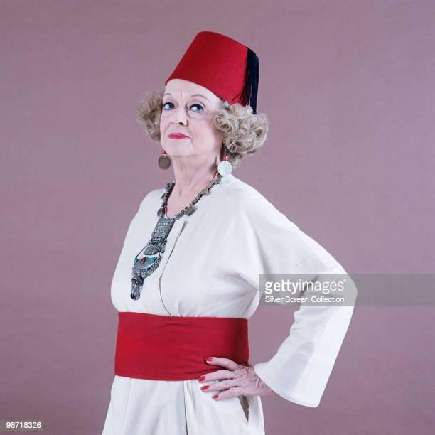 American actress Bette Davis wearing a fez circa 1970
