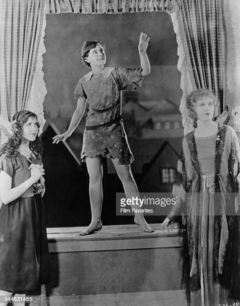 American actress Betty Bronson as the eponymous hero of the film 'Peter Pan' 1924 On the left is Mary Brian as Wendy and on the right Esther Ralston...