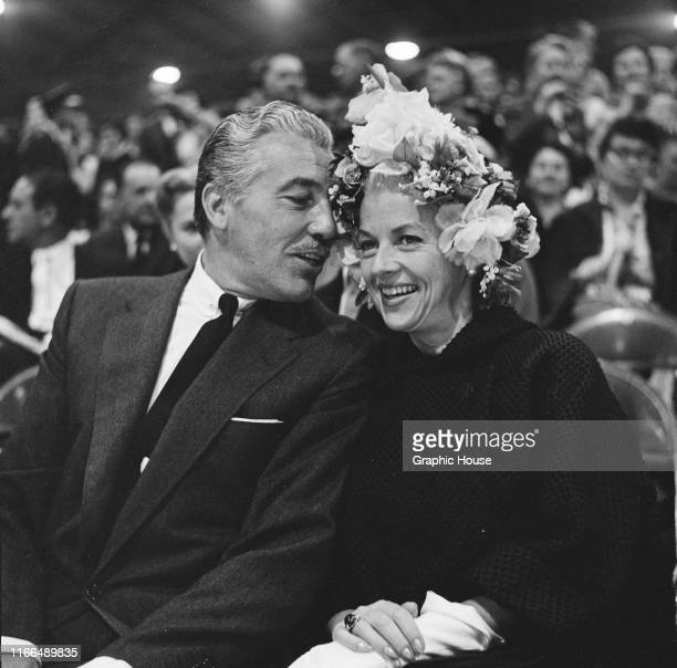 American actress Betty Furness with actor and singer Cesar Romero at an event, USA, circa 1957.