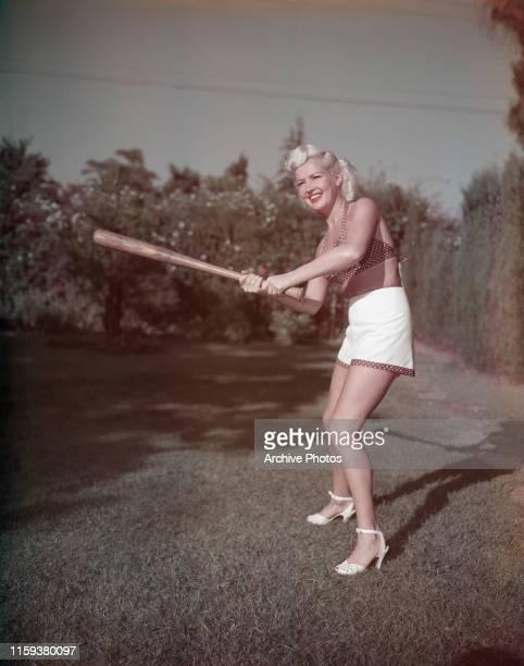 American actress Betty Grable with a baseball bat circa 1950