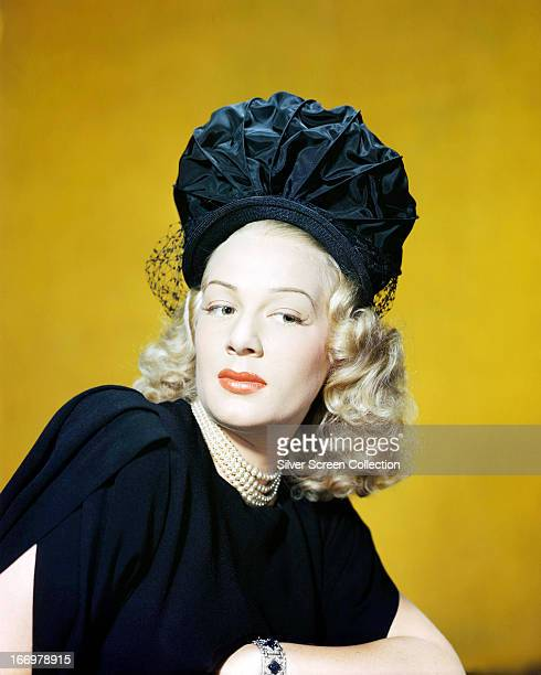 American actress Betty Hutton wearing a hat in black ruched satin circa 1950