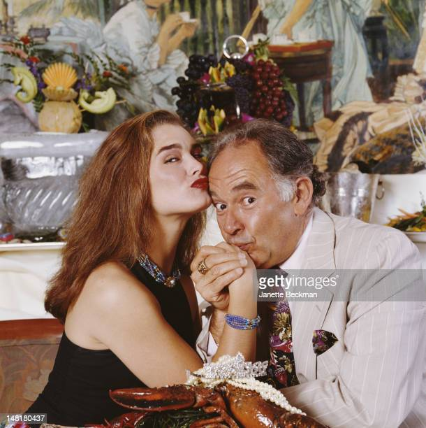 American actress Brooke Shields and reporter Robin Leach pose with a bejewelled lobster New York City 1999