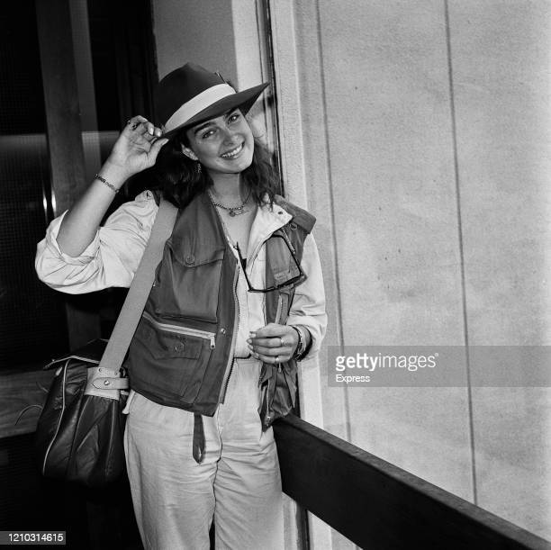 American actress Brooke Shields holding the brim of the fedora she is wearing at Heathrow Airport in London England 23rd July 1984
