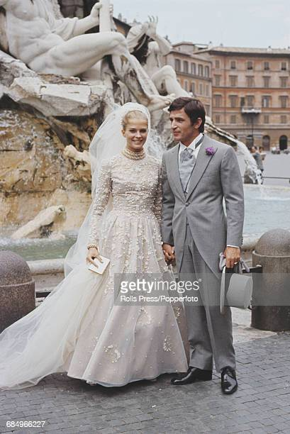 American actress Candice Bergen pictured wearing a wedding dress with Yugoslavian actor Bekim Fehmiu during the shooting of a scene from the film...