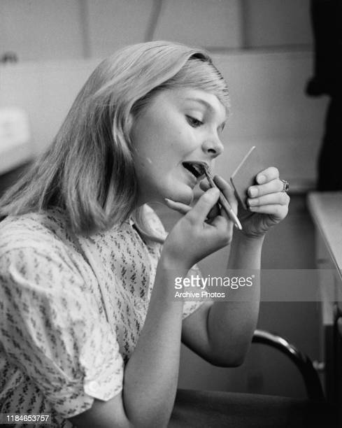 American actress Carol Lynley applying her makeup circa 1960