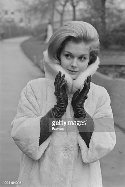 American actress Carol Lynley, who stars in the film The Cardinal, pictured wearing a winter coat and leather gloves in a London park on 17th...