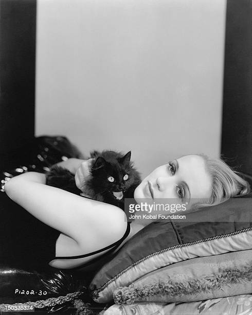 American actress Carole Lombard with a wideeyed black cat circa 1935