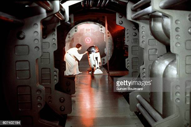 American actress Carrie Fisher and British actor Kenny Baker on the set of Star Wars Episode IV A New Hope written directed and produced Georges Lucas