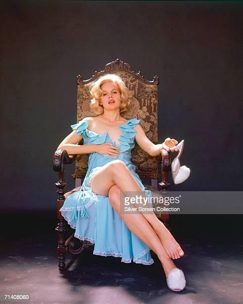 American actress Carroll Baker in a sultry bedtime scenario circa 1955