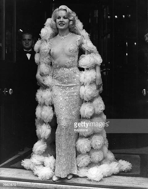 American actress Carroll Baker in London dressed in a transparent dress designed by Balmain