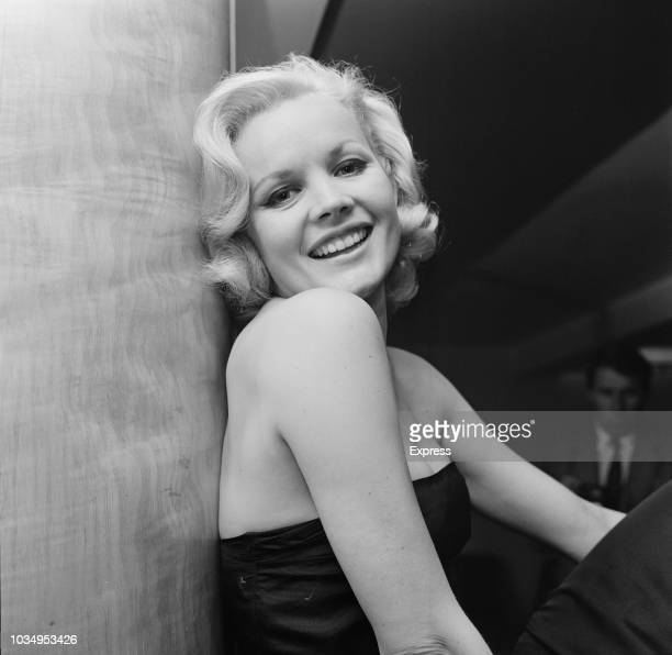 American actress Carroll Baker posed wearing a black strapless evening dress at an event in London on 9th September 1963 Carroll Baker is currently...
