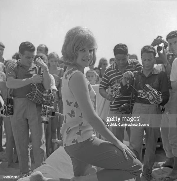 American actress Carroll Baker posing for the photographers on the beach Lido Venice 1961
