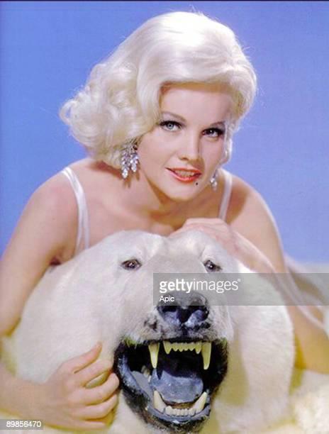 American actress Carroll Baker with stuffed polar bear c 1964
