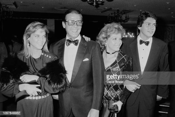 American actress Catherine Oxenberg English actor Roger Moore Italian actress Luisa Mattioli and Geoffrey Moore attend gala dinner to honour Prince...