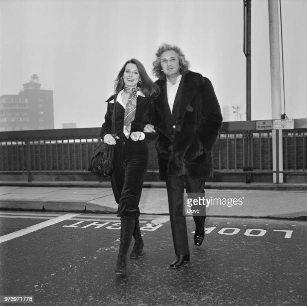 American actress Celeste Yarnall pictured with English film director Michael Winner at Heathrow airport in London on 28th February 1972 Michael...