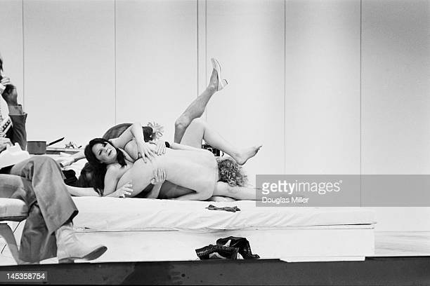 American actress Cherry Vanilla in a group sex scene from Andy Warhol's play 'Pork' 29th July 1971 The scene is being performed at a photocall...