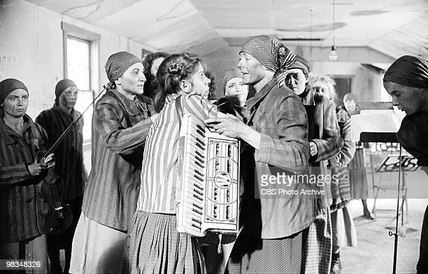 American actress Christine Baranski who holds an accordion and British actress Vanessa Redgrave appear with a number of unidentified actresses in a...