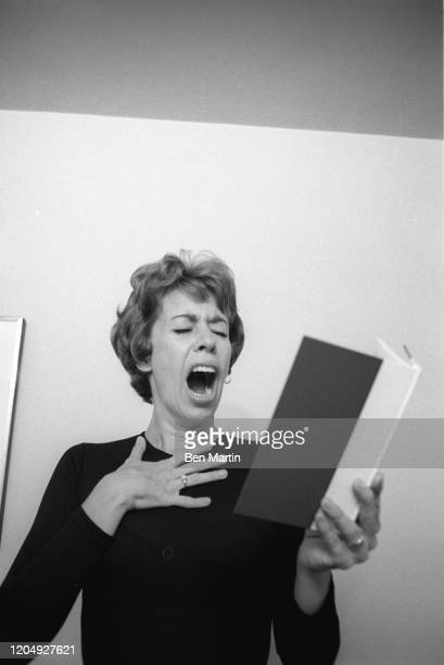 American actress, comedian, singer, and writer Carol Burnett clowning in her New York apartment, May 1963.