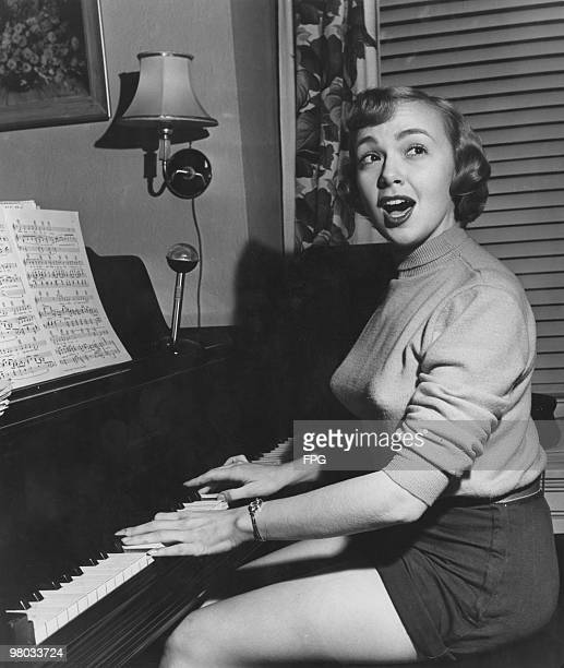 American actress comedienne and singer Edie Adams accompanies herself on the piano at her home in Tenafly New Jersey circa 1950