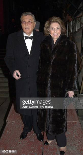 American actress Cyd Charisse arrives with a companion at the London Palladium for a tribute event to remember Hollywood legend Fred Astaire The show...