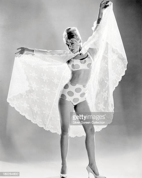American actress dancer and singer Joey Heatherton posing in a white negligee and a polkadot bikini circa 1965