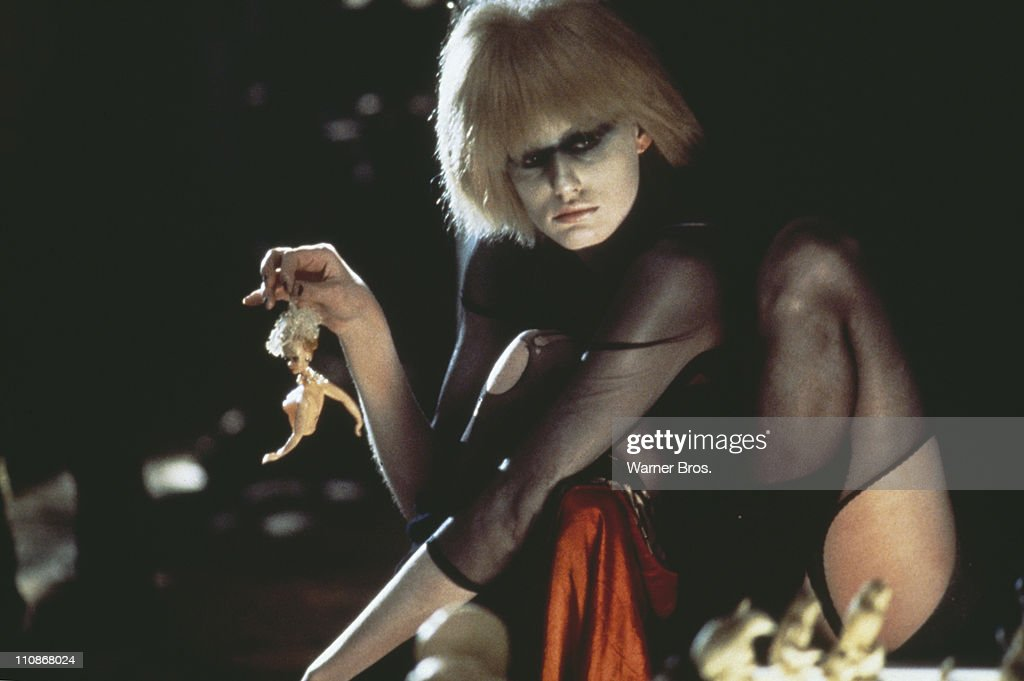 American actress Daryl Hannah, as the replicant Pris, holding a broken doll in a scene from Ridley Scott's futuristic thriller 'Blade Runner', 1982.