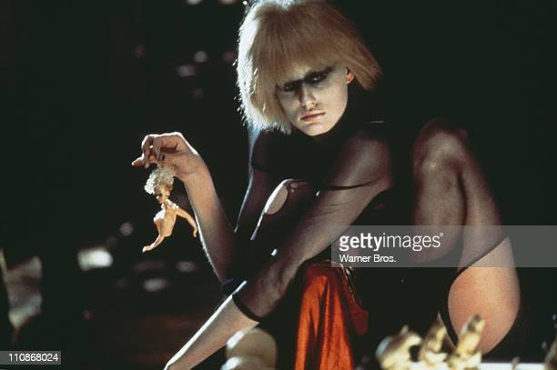 American actress Daryl Hannah as the replicant Pris holding a broken doll in a scene from Ridley Scott's futuristic thriller 'Blade Runner' 1982