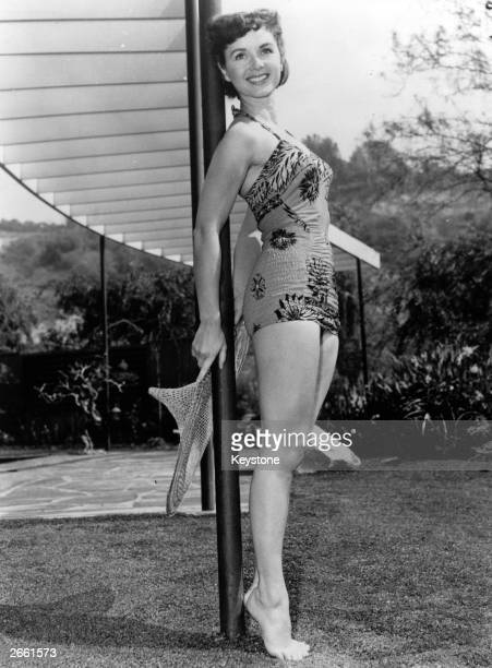 American actress Debbie Reynolds modelling a swimsuit in the garden Original Publication People Disc HK0134