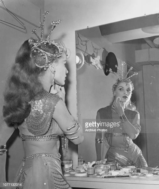 American actress Debra Paget touches up her makeup in the dressing room circa 1955