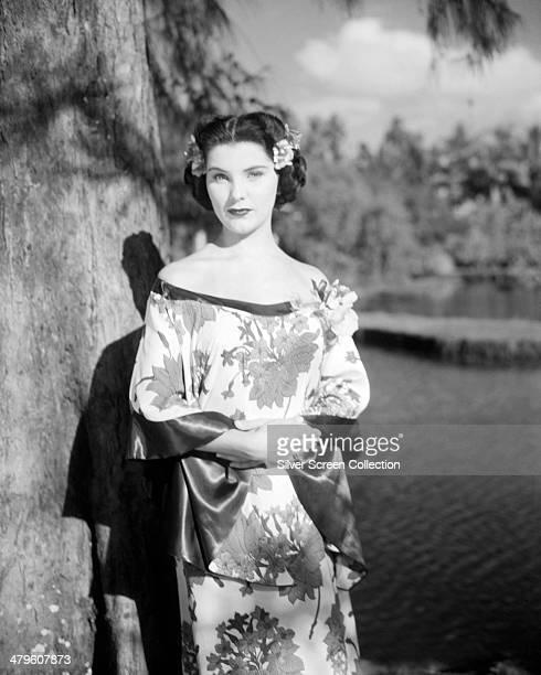 American actress Debra Paget wearing a silk, oriental-style dress, circa 1950.