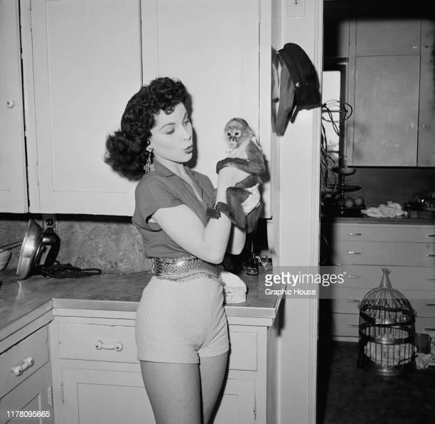 American actress Debra Paget with a pet monkey circa 1955