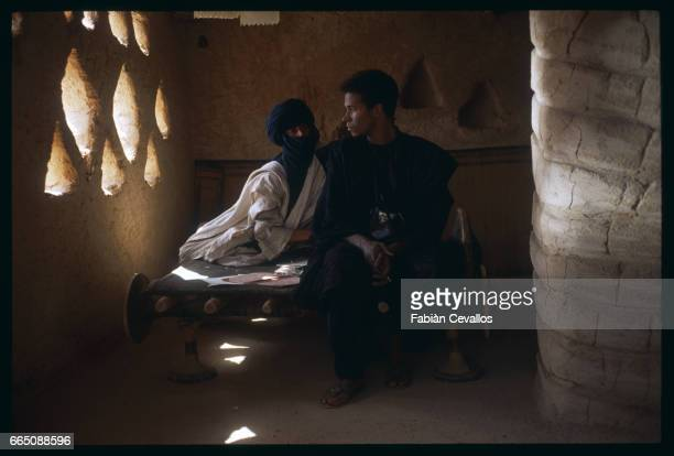 American actress Debra Winger sits next to actor Eric VuAn in a halflit room during the shooting of the movie Un The au Sahara or Il Te Nel Deserto...