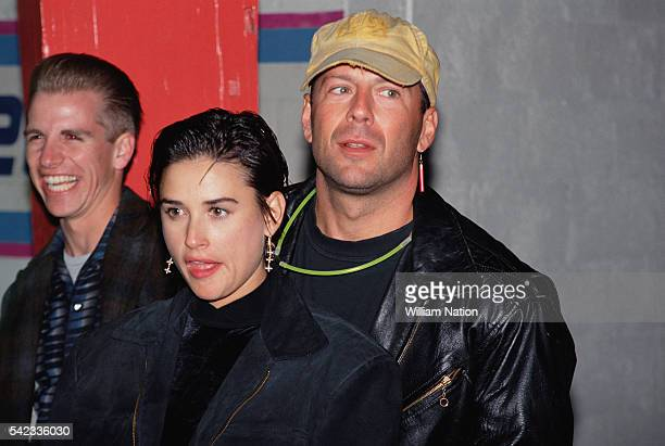 American actress Demi Moore and her husband actor Bruce Willis attend Moore's 30th birthday party celebration at Six Flags Magic Mountain amusement...