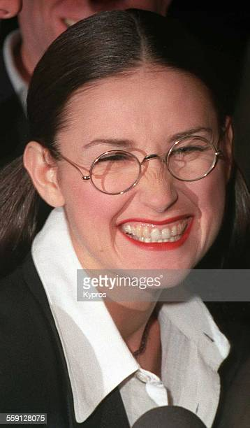 American actress Demi Moore in spectacles circa 1990