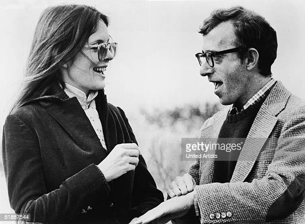 American actress Diane Keaton and American film director and actor Woody Allen talk in still from the film 'Annie Hall' written and directed by Allen...