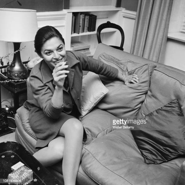 American actress, director, screenwriter and singer Anne Bancroft smoking a cigarette, UK, 20th August 1968.