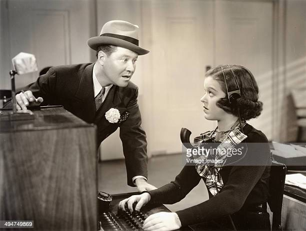 American actress Dixie Dunbar plays switchboard operator Marie opposite actor Jack Oakie in a scene from the film 'King of Burlesque' 1936