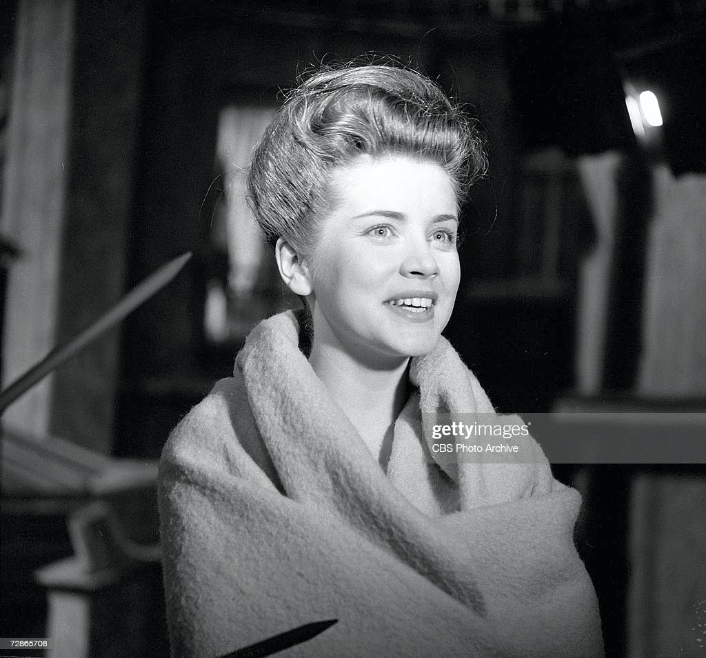 American actress Dolores Hart smiles while wrapped in a blanket during the filming of the CBS television Playhouse 90 production of 'To the Sound of Trumpets,' February 8, 1960.