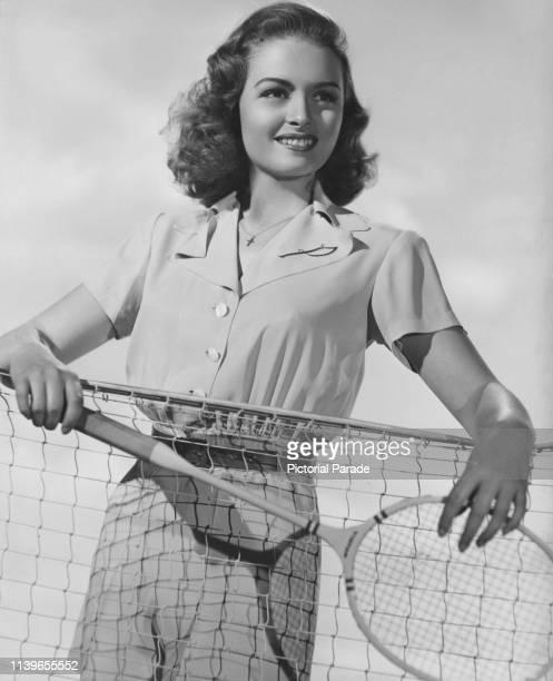 American actress Donna Reed playing badminton, circa 1945.