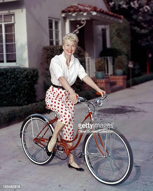 American actress Doris Day riding a Schwinn bicycle circa 1955