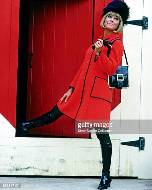 American actress Doris Day wearing a red coat and black hat circa 1960