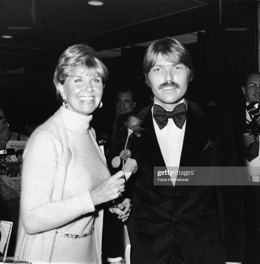 American actress Doris Day with her son, American rock producer and songwriter Terry Melcher (1942 - 2004), at the annual Thalians Ball benefit, Los Angeles, California, October 1974. Day holds a rose.