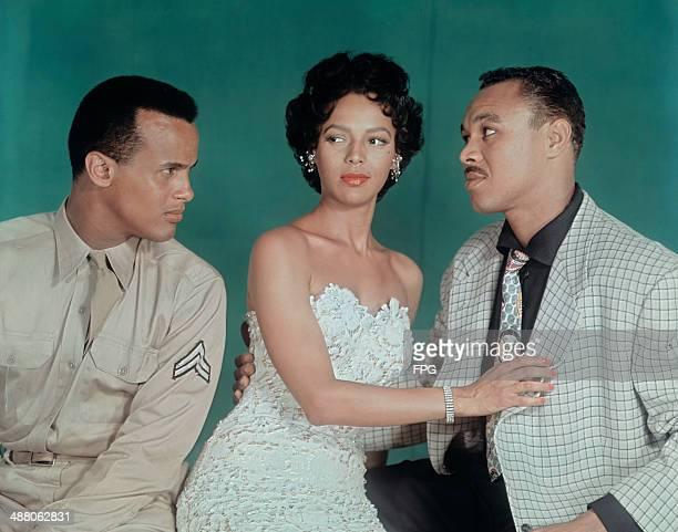American actress Dorothy Dandridge with actors Harry Belafonte and Joe Adams in a publicity still from the film 'Carmen Jones' 1954