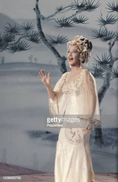 American actress Dorothy Lamour pictured singing in a cameo scene during production of the film 'The Road to Hong Kong' at Shepperton Studios in...