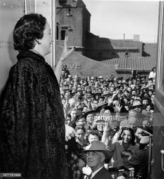 American actress Dorothy Lamour waves to fans from the train on her way to the grand opening of the Shamrock Hotel in Houston Texas March 1949