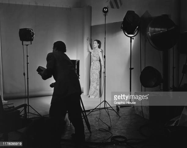 American actress Dorothy Lamour wearing a floral pattern evening dress for a photoshoot circa 1945