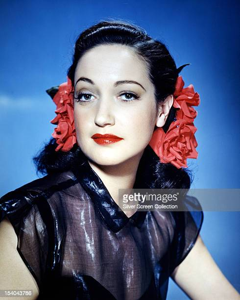American actress Dorothy Lamour wearing red ribbons in her hair circa 1945